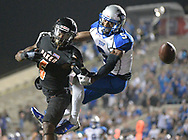 St. Francis defensive back Jerrell Holman (5) breaks up a pass intended for Baker receiver Quanzee Johnson (6) during the second half of the NAIA championship football game in Daytona Beach, Fla., Saturday, Dec. 17, 2016. St. Francis won 38-17. (AP Photo/Phelan M. Ebenhack)