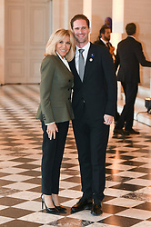 French President's wife Brigitte Macron welcomes Luxembourg's Prime Minister's husband Gauthier Destenay as they take part in a spousal event at the Chateau de Versailles in Versailles, near Paris, on November 11, 2018 as part of commemorations marking the 100th anniversary of the 11 November 1918 armistice, ending World War I. Photo By Laurent Zabulon/ABACAPRESS.COM