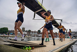 © Licensed to London News Pictures. 28/06/2017. London, UK. A Kings College rowing team leaves the water after a race on day one of the Henley Royal Regatta, set on the River Thames by the town of Henley-on-Thames in England.  Established in 1839, the five day international rowing event, raced over a course of 2,112 meters (1 mile 550 yards), is considered an important part of the English social season. Photo credit: Ben Cawthra/LNP