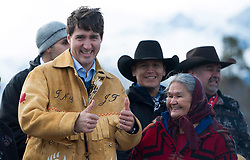 Prime Minister Justin Trudeau gives the thumbs up after receiving a handmade jacket following a ceremony near Chilko Lake, B.C.,Friday, Nov. 2, 2018. The Prime Minister was in the area to apologize to the Tsilhqot'in community for the hangings of six chiefs during the so-called Chilcotin War over 150 years ago. Photo by The Canadian Press /Jonathan Hayward/ABACAPRESS.COM