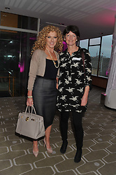 Left to right, KELLY HOPPEN and BRIGID McCONVILLE director of the White Ribbon Alliance for Safe Motherhood ( UK) at a private view of photographs by Joanna Vestey entitled 'Dreams For My Daughter' in aid of The White Ribbon Alliance, held at The Royal Festival Hall, South Bank, London on 8th March 2012.