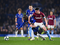 Football - 2018 / 2019 Premier League - Chelsea vs. West Ham United<br /> <br /> Chelsea's Ngolo Kante holds off the challenge from West Ham United's Declan Rice, at Stamford Bridge.<br /> <br /> COLORSPORT/ASHLEY WESTERN