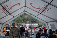 Police and Jandarma wait under a Turkish Red Crescent tent as the rescue effort for surviving miners continue behind them. An explosion caused by an electrical fault in Somas' coal mine resulted in at least 282 deaths. Rescue efforts continue into the third evening. Soma, western Turkey.
