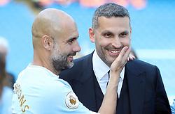 Manchester City manager Pep Guardiola (left) celebrates with chairman Khaldoon Al Mubarak after the Premier League match at the Etihad Stadium, Manchester.