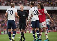 Football - 2019 / 2020 Premier League - Arsenal vs. Tottenham Hotspur<br /> <br /> Harry Kane (Tottenham FC)  protests to Referee Martin Atkinson at The Emirates.<br /> <br /> COLORSPORT/DANIEL BEARHAM