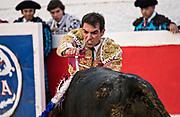 Mexican Bullfighter Arturo Macías thrusts a sword into a bull during a bullfight at the Plaza de Toros March 4, 2018 in San Miguel de Allende, Mexico.