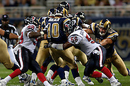 St. Louis Rams quarterback Marc Bulger (10) is sacked in the first quarter, by Houston's Morlon Greenwood (56) and Antwan Peek (98) at the Edward Jones Dome in St. Louis, Missouri, August 19, 2006.  The Texans beat the Rams 27-20.