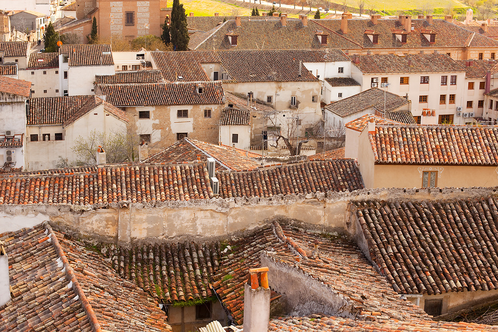 Close-up detail to the red tiled roofs of old house of traditional Spanish architecture, Chinchon, Spain