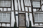 Medieval architecture of houses along the High Street of wool town, Lavenham, on 9th July 2020, in Lavenham, Suffolk, England. By the late 15th century, the town was among the richest in the British Isles, paying more in taxation than considerably larger towns such as York and Lincoln. Several merchant families emerged, the most successful of which was the Spring family. became a prosperous town based on cloth making. The wool trade was already present by the 13th century, steadily expanding as demand grew. By the 1470s Suffolk produced more cloth than any other county.