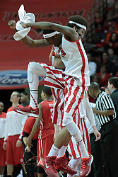 15 February 2014:  Jamaal Samuel give Reggie Lynch a high hip bump after Reggie Lynch smashes a shot rejection and Geno Ford calls a time out during an NCAA Missouri Valley Conference (MVC) mens basketball game between the Bradley Braves and the Illinois State Redbirds  in Redbird Arena, Normal IL.