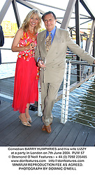 Comedian BARRY HUMPHRIES and his wife LIZZY at a party in London on 7th June 2004.PUW 57
