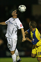 Photo: Rich Eaton.<br /> <br /> Torquay United v Norwich City. Carling Cup. 23/08/2006. Ian Henderson of Norwich heads the ball watched by Kevin Hill of Torquay
