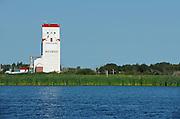 grain elevator and wetland on the Canadian prairie<br /> Whitewood<br /> Saskatchewan<br /> Canada