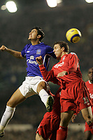 Photo: Dave Howarth.<br /> Everton v Liverpool. The Barclays Premiership. 28/12/2005. Tim Cahill and Stephen Warnock in action