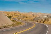 Road swings through the Badlands National Park, South Dakota, USA