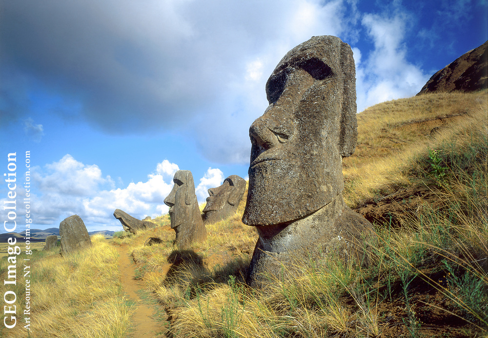 """Monuments to notables long dead, aringa ora, or """"living faces,"""" gaze impassively from the flank of an Easter Island volcano."""