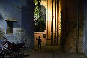 Child walks through alley. Jodhpur, India