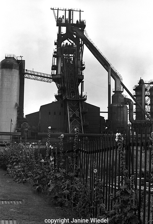 Elizaberh Furnace, Bilston Iron and Steel works, Wolverhampton, West Midlands in 1978.The furnace was constructed in 1953 &1954 to replace 3 existing blast furnaces on the site.It was named after Elizabeth Margaret Steward, the daughter of the owner of the company.It was the most advanced furnace of its kind in the UK and could produce 275,00-325,000 tons of iron per year.Due to increasing stock levels of iron across British Steel Corporation it was mothballed for 6 months in 1977. It never worked again and was demolished in 1980.