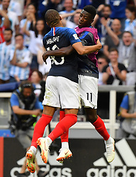 France's Kylian Mbappe celebrates scoring with teammate Ousmane Dembele during the FIFA World Cup France v Argentina at the Kazan Arena stadium in Kazan, Russia on June 30, 2018. Teenage star Kylian Mbappe struck twice and earned another goal as France defeated Argentina 4-3 and move into the quarter-finals. Photo by Christian Liewig/ABACAPRESS.COM