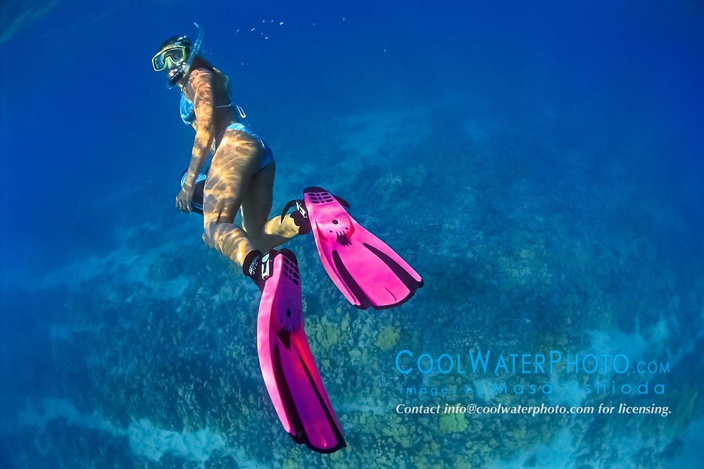woman snorkeler with housed underwater video camera, diving over coral reef, Kiholo Bay, Kohala Coast, Big Island, Hawaii, USA, Pacific Ocean, MR