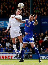 Josh Vela of Bolton Wanderers challenges Peter Clarke of Oldham Athletic - Mandatory by-line: Matt McNulty/JMP - 15/04/2017 - FOOTBALL - Boundary Park - Oldham, England - Oldham Athletic v Bolton Wanderers - Sky Bet League 1