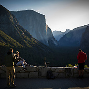 People watch the sunrise at Tunnel View inside Yosemite National Park on Sunday, September 22, 2019 in Yosemite, California. (Alex Menendez via AP)