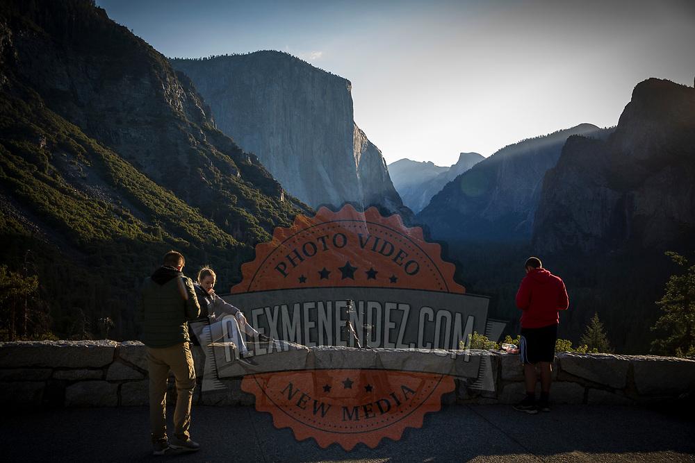 People watch the sunrise at Tunnel View inside Yosemite National Park on Sunday, September 22, 2019 in Yosemite, California. (Alex Menendez via AP)