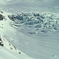 Bearing heavy packs, ski mountaineers Allan Pietrasanta and Jay Jensen descend below 16,000 foot Warwan Pass during a pioneering two-week ski expedition from Ladakh to Kashmir, across India's Great Himalaya Range.