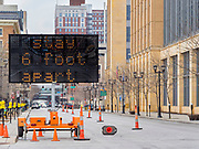 15 APRIL 2020 - DES MOINES, IOWA: A sign urging people to social distance on Locust Street in downtown Des Moines. Authorities closed the street to increase social distancing and discourage cruising through downtown. Most non-essential businesses in Iowa are closed until 30 April. Because of business closings caused by the Novel Coronavirus (SARS-CoV-2) pandemic, downtown Des Moines is nearly deserted but some people come downtown in the evenings to cruise and authorities are worried that spectators are not social distancing.     PHOTO BY JACK KURTZ