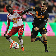 Will Bruin, (right), Houston, is challenged by Kemar Lawrence, New York Red Bulls, during the New York Red Bulls Vs Houston Dynamo, Major League Soccer regular season match at Red Bull Arena, Harrison, New Jersey. USA. 19th March 2016. Photo Tim Clayton