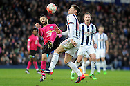 Peterborough's Erhun Oztumer (l) challenges West Brom's Sebastien Pocognoci. The Emirates FA Cup, 4th round match, West Bromwich Albion v Peterborough Utd at the Hawthorns stadium in West Bromwich, Midlands on Saturday 30th January 2016. pic by Carl Robertson, Andrew Orchard sports photography.