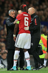 12th September 2017 - UEFA Champions League - Group A - Manchester United v FC Basel - Man Utd manager Jose Mourinho removes the captain's armband from Paul Pogba of Man Utd after he left the pitch injured - Photo: Simon Stacpoole / Offside.