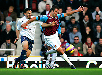 Photo: Tom Dulat/Sportsbeat Images.<br /> <br /> West Ham United v Tottenham Hotspur. The FA Barclays Premiership. 25/11/2007.<br /> <br /> Lucas Neill of West Ham United and Steed Malbranque of Tottenham Hotspur with the ball.