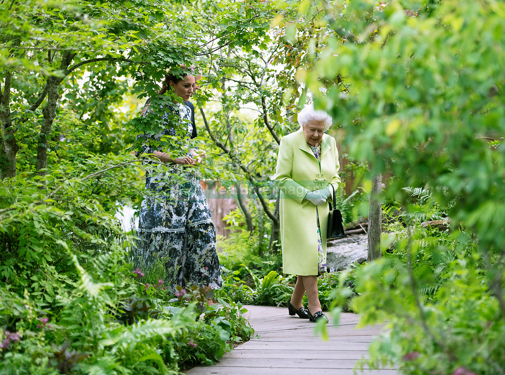 Queen Elizabeth II is shown around the 'Back to Nature' by the designer, The Duchess of Cambridge during their visit to the RHS Chelsea Flower Show at the Royal Hospital Chelsea, London.