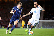 Scotland forward James Forrest (7) (Celtic) takes on Fedor Kudryashov of Russia (13) (Sochi) during the UEFA European 2020 Qualifier match between Scotland and Russia at Hampden Park, Glasgow, United Kingdom on 6 September 2019.