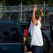 Armando Lira threw his arms in the air in the parking lot of the Kansas Juvenile Correctional Complex in Topeka, Kan. on September 5, 2008, where Lira had been a prisoner after his 2006 conviction for aggravated robbery. After serving his time, Lira was released to return to Kansas City, Kan. with his mother. (David Eulitt/Kansas City Star).