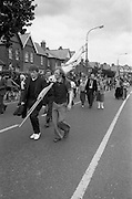 H-Block Protest To British Embassy.  (N86)..1981..18.07.1981..07.18.1981..18th July 1981..A protest march to demonstrate against the H-Blocks in Northern Ireland was held today in Dublin. After the death of several hunger strikers in the H-Blocks feelings were running very high. The protest march was to proceed to the British Embassy in Ballsbridge...Image shows many of the marchers leaving the protest march and starting to head home.