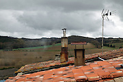 old chimneys and antenna on residential roof