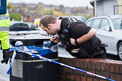 South Yorksire Police officers checks a bin for possible evidnce at the Crime Scene on Halifax Road stretching from Kilner way to Southey Green Rd. Locals information say the crime was a stabbing.<br /> <br /> 29 October 2015<br />  Image © Paul David Drabble <br />  www.pauldaviddrabble.co.uk