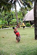 Samoan man with traditional tattoos playing cricket. Oahu, Hawaii