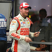 Driver Dale Earnhardt Jr. laughs at fans wanting to speak with him during the 56th Annual NASCAR Daytona 500 practice session at Daytona International Speedway on Wednesday, February 19, 2014 in Daytona Beach, Florida.  (AP Photo/Alex Menendez)