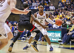 Dec 14, 2019; Morgantown, WV, USA; West Virginia Mountaineers guard Brandon Knapper (2) passes the ball around Nicholls State Colonels guard Dexter McClanahan (22) during the second half at WVU Coliseum. Mandatory Credit: Ben Queen-USA TODAY Sports