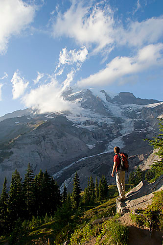 Young man hiking in Paradise Park in Mount Rainier National Park, WA