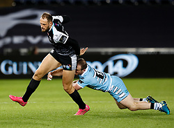 Cory Allen of Ospreys evades the tackle of  Nick Grigg of Glasgow Warriors<br /> <br /> 2nd November, Liberty Stadium , Swansea, Wales ; Guinness pro 14's Ospreys Rugby v Glasgow Warriors ;  <br /> <br /> Credit: Simon King/News Images<br /> <br /> Photographer Simon King/Replay Images<br /> <br /> Guinness PRO14 Round 8 - Ospreys v Glasgow Warriors - Friday 2nd November 2018 - Liberty Stadium - Swansea<br /> <br /> World Copyright © Replay Images . All rights reserved. info@replayimages.co.uk - http://replayimages.co.uk