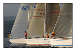 Yachting- The first days racing  of the Bell Lawrie Scottish series 2003 at Gourock. Waiting for the gun. The sun briefly  shone at the start which looks set rain the overnight race to Tarbert...Sloop John T, Iain and Graham Thomson's Swan 40, Inis Mor a Sunfast 40 and Crackerjack a new Swan 45. Class two....Pics Marc Turner / PFM