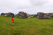 Visitor exploring Elephant Rocks, Canterbury, South Island, New Zealand