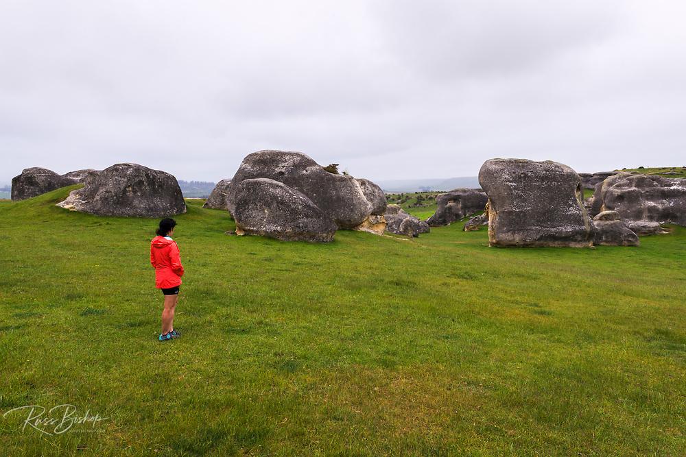 Visitor exploring Elephant Rocks, Canterbury, South Island, New Zealand
