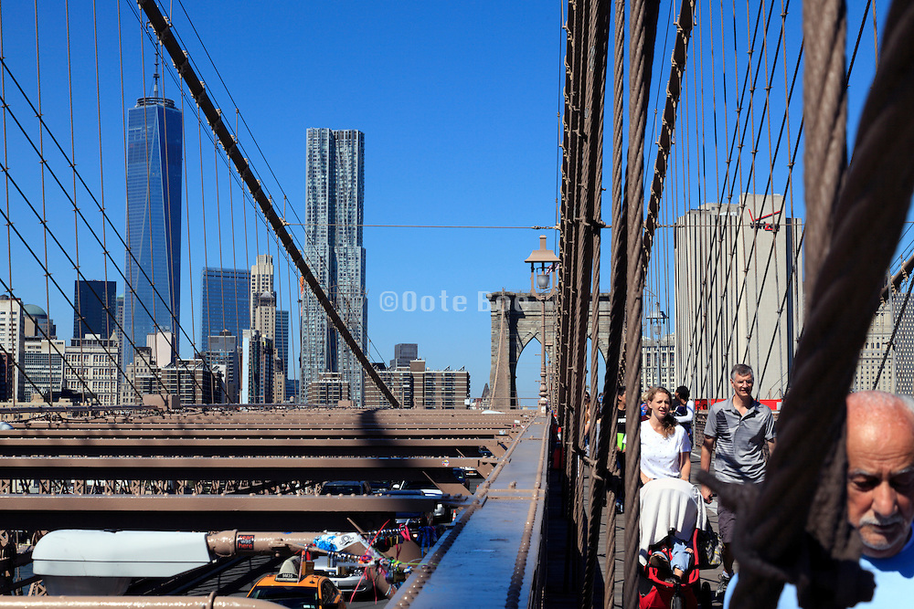 WTC with the Frank Gehry residential building and Brooklyn Bridge in Downtown New York City