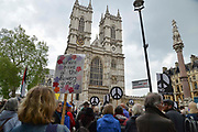 Demonstrators from Campaign For Nuclear Disarmament CND and  religious groups opposite Westminster Abbey as a national service of Thanksgiving to mark fifty years of the Continuous at Sea Deterrent CASD takes place at Westminster Abbey on 3rd May 2019 in London, England, United Kingdom.