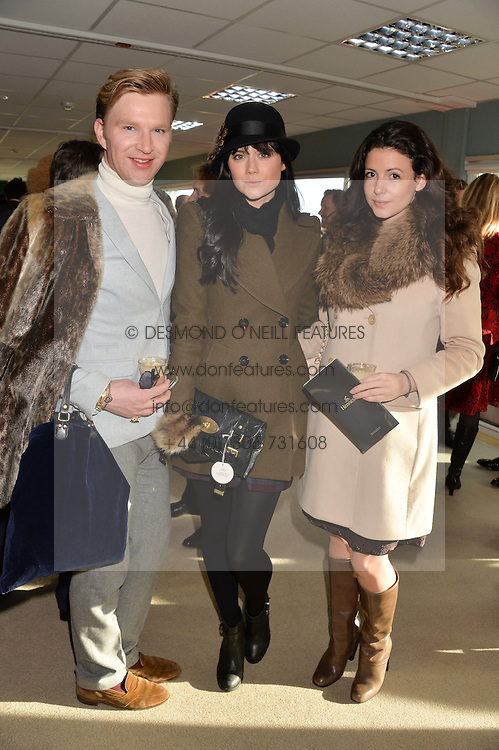 Left to right, HENRY CONWAY, LILAH PARSONS and SHIRLEY LEIGH WOOD-OAKES at the 2013 Hennessy Gold Cup at Newbury Racecourse, Berkshire on 30th November 2013.